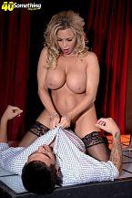 Busty MILF lap dancer Amber Lynn offers extras